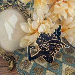 black and gold angel enamel pin