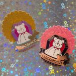 """gold metal enamel pin with bear in a coffin saying """"here lies my childhood"""""""
