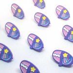 pastek eyes doll enamel pin with stars and rainbow